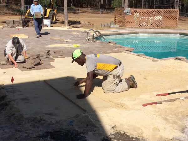 Landscape jobs at T. Lake range from hardscape installation to commercial mowing