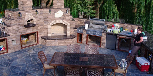 Adding An Outdoor Kitchen Is One Hardscape Idea For A Large Backyard Makeover